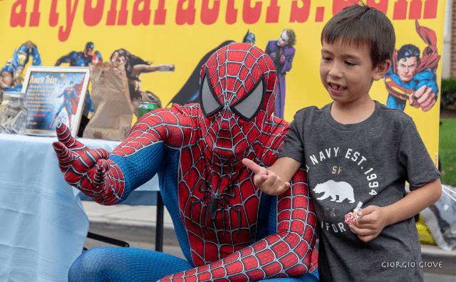 Spiderman with child slinging web